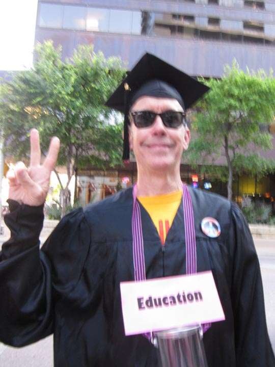 "Man dressed in graduation robes, labeled ""Education"""