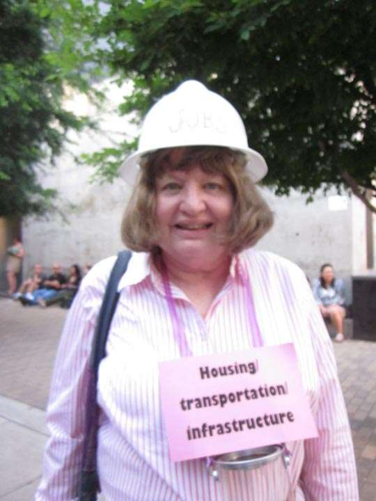 "Woman in hard-hat, labeled ""Housing, transportation, infrastructure"""
