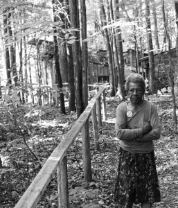 Photo of Juanita Nelson at Woolman Hill. The house she shared for many years with Wally is in the background. Photo by Ed Hedemann.