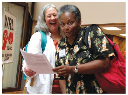 Joanne Sheehan, organizer for the Gathering, and Mandy Carter, who will speak on Saturday. Photo by Linda Thurston.