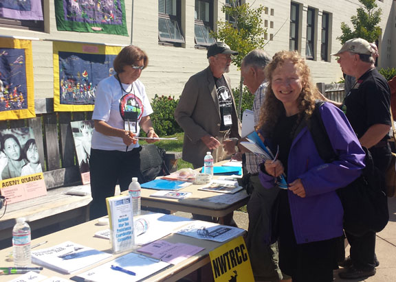 "Anne Barron set up the NWTRCC/war tax resistance literature table at the 31st Annual Veterans for Peace Convention in Berkeley, California. ""Peace at Home, Peace Abroad; A Just and Sustainable Future for the World's Children"" was the theme of the convention, which was held August 11–15."