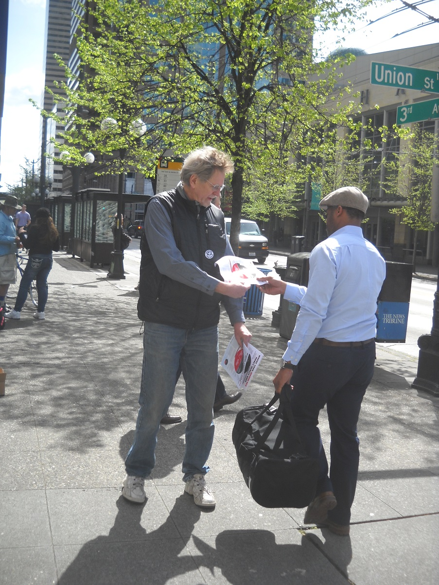 A member of Veterans for Peace leaflets in downtown Seattle, April 15, 2014.