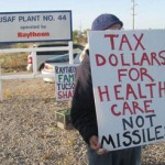 "sign reading ""Tax Dollars for Health Care Not Missiles"""