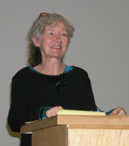 Kathy Kelly standing at a podium
