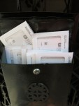 image of black mailbox with 10 IRS envelopes sticking out the top