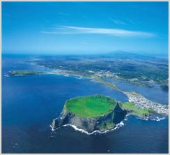 aerial view of the green Jeju Island in a blue sea and sky