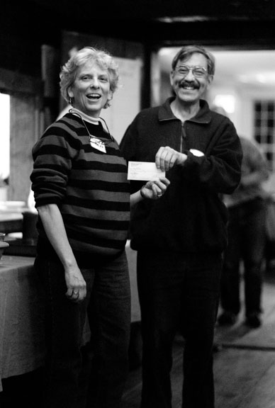 Ruth Benn receiving a check from Larry Dansinger