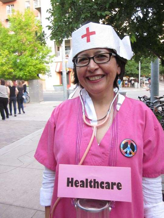"Woman dressed as health-care provider, labeled ""Healthcare"""