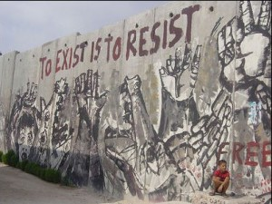 mural on a wall in Palestine, with the slogan 'to exist is to resist'