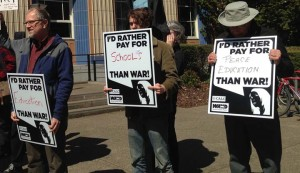 Signs on tax day in Eugene, Oregon