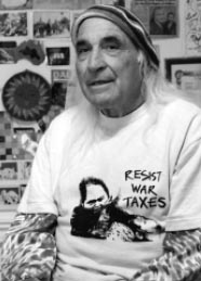 "Tony Serra wearing a t-shirt that says ""Resist War Taxes"""