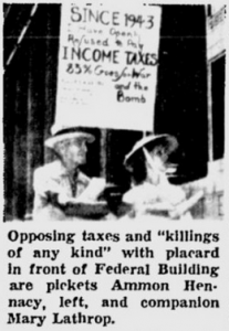"Opposing taxes and ""killings of any kind"" with placard in front of Federal Building are pickets Ammon Hennacy, left, and companion Mary Lathrop."