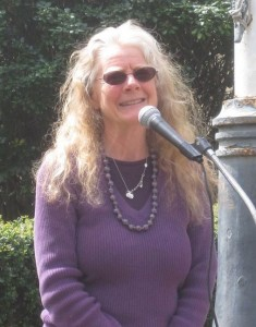 Sue Barnhart speaking into a microphone
