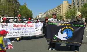 war tax resisters holding banner march alongside D.C. statehood advocates