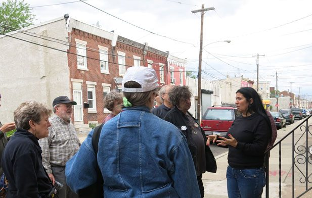 Cheri Honkala (right) talks to the assembled war tax resisters during our tour of Kensington.