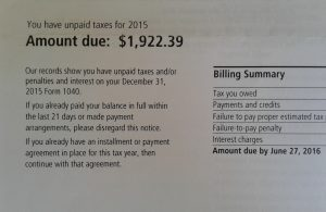 "image of IRS letter with heading ""You have unpaid taxes for 2015 - Amount due: $1,922.39"""