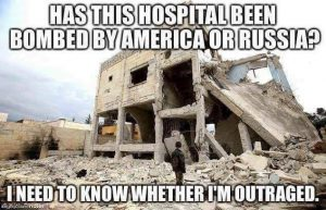 "A bombed-out building with walls falling or fallen down with the words printed over the top: ""Has this hospital been bombed by America or Russia? I need to know whether I'm outraged."""