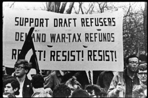 demonstrators with resist taxes and resist the draft banner