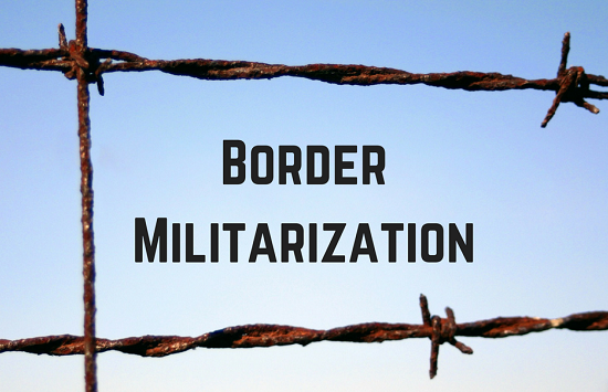 "barbed wire fence with text ""Border Militarization"" displayed between two rows of wire"