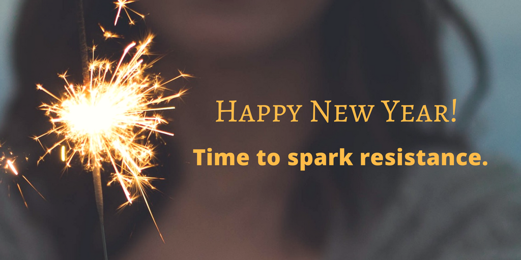 "photo of a sparkler with the words ""Happy New Year! Time to spark resistance."""