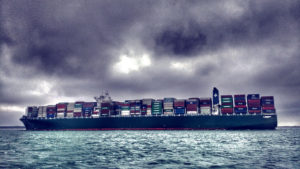 image of a container ship loaded up at sea