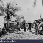 People of Bikini Atoll carry their possessions to ships as part of forced relocation