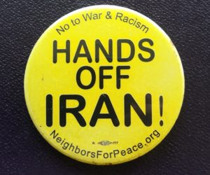 "Yellow button with words ""No to War & Racism- HANDS OFF IRAN- Neighbors for Peace. org"