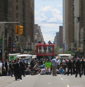 Demonstrators block 8th Avenue in Manhattan