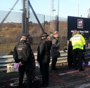 police speak to vigil particpants outside Faslane naval base, where Trident nuclear submarines are kept