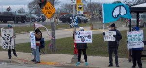 5 members of Milwaukee WTR hold signs in front of a street sign that says Dead End