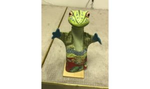 Green frog with hands outstretched