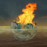 image of earth engulfed in flames in brown water